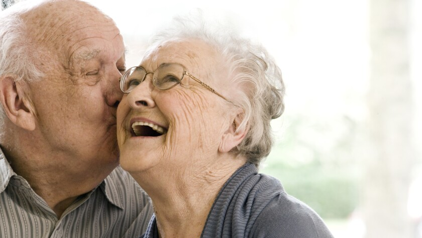 Elderly Man and Woman on Couch in Nursing Home