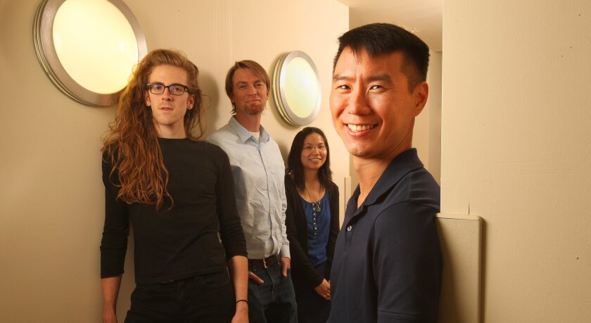 """Scripps Research Institute scientist Andrew Su, right. From the left are his colleagues: Max Nanis, research programmer; Ben Good, assistant professor; and Ginger Tsueng, scientific outreach project manager. They have started a program called Mark2Cure that will use """"citizen scientists"""" to help res"""