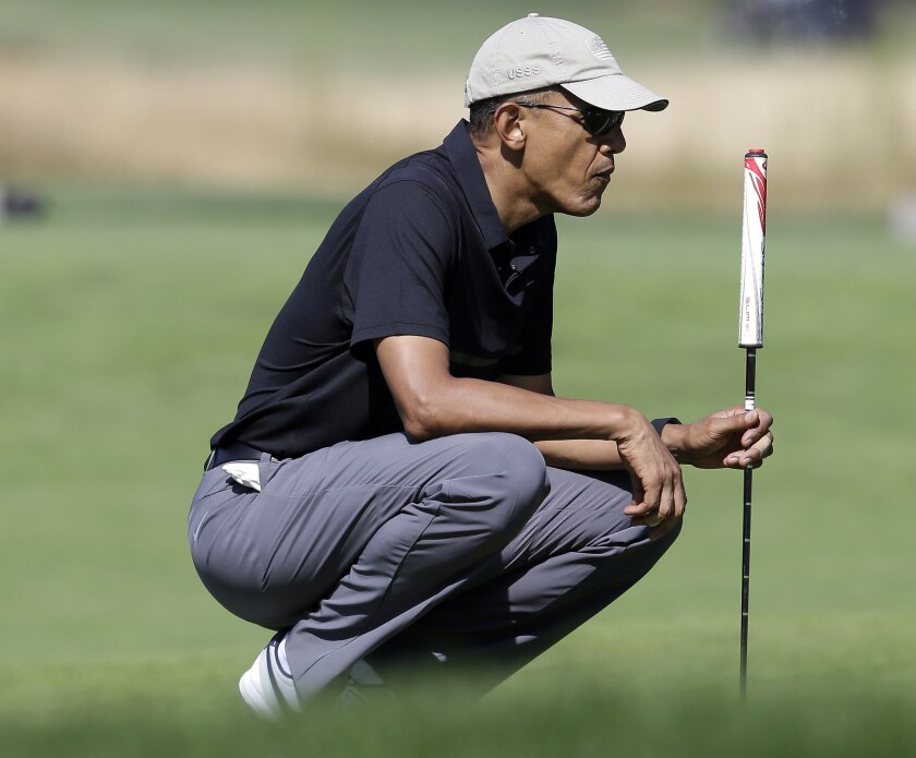 President Obama plays golf Monday at Vineyard Golf Club on Martha's Vineyard.