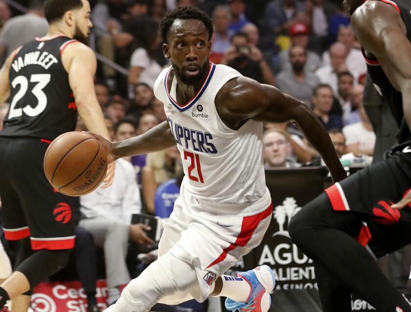 Clippers guard Patrick Beverley runs the offense during a game against the Toronto Raptors on Nov. 11, 2019, at Staples Center.