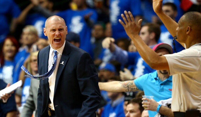 Mavericks Coach Rick Carlisle questions a call during Game 3 of his team's playoff series against the Rockets in Dallas on April 24.