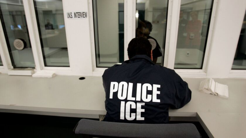 December 28, 2006, San Diego, California, USA . Immigration and Customs Enforcement officers interr