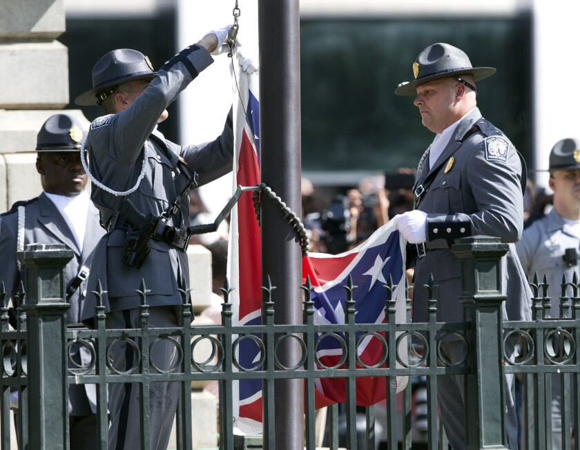 An honor guard from the South Carolina Highway Patrol lowers the Confederate battle flag as it is removed from the Capitol grounds on July 10 in Columbia, S.C.