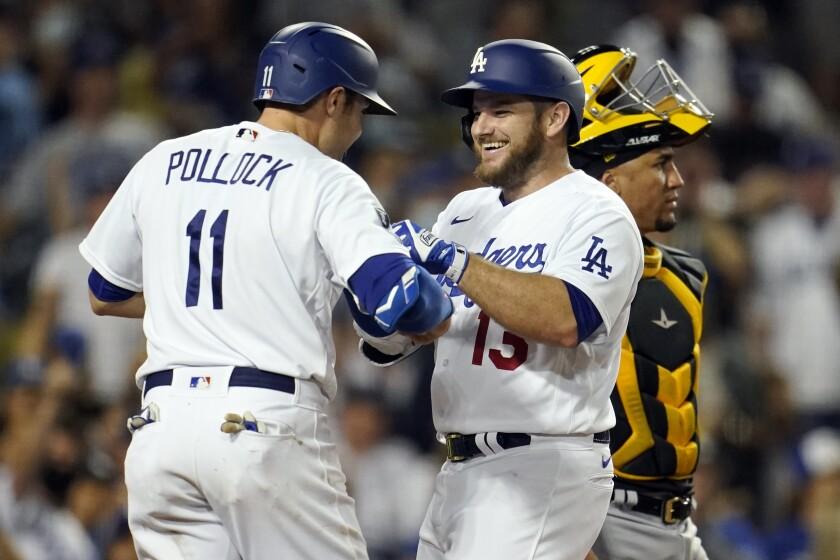 Dodgers' Max Muncy celebrates his three-run home run with AJ Pollock.
