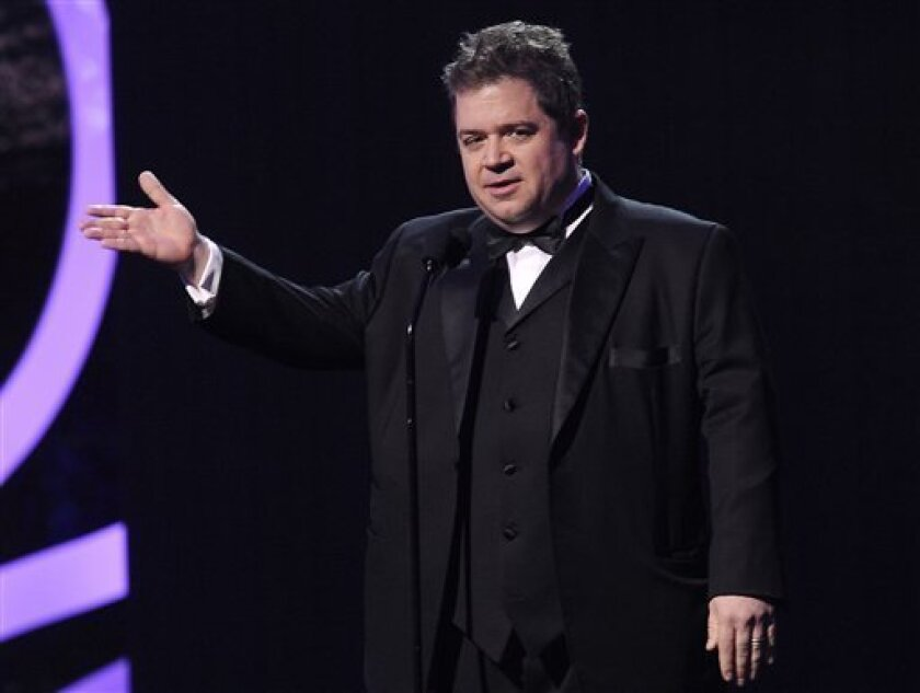 FILE - In this Jan. 12, 2012 file photo, actor-comedian Patton Oswalt is seen onstage