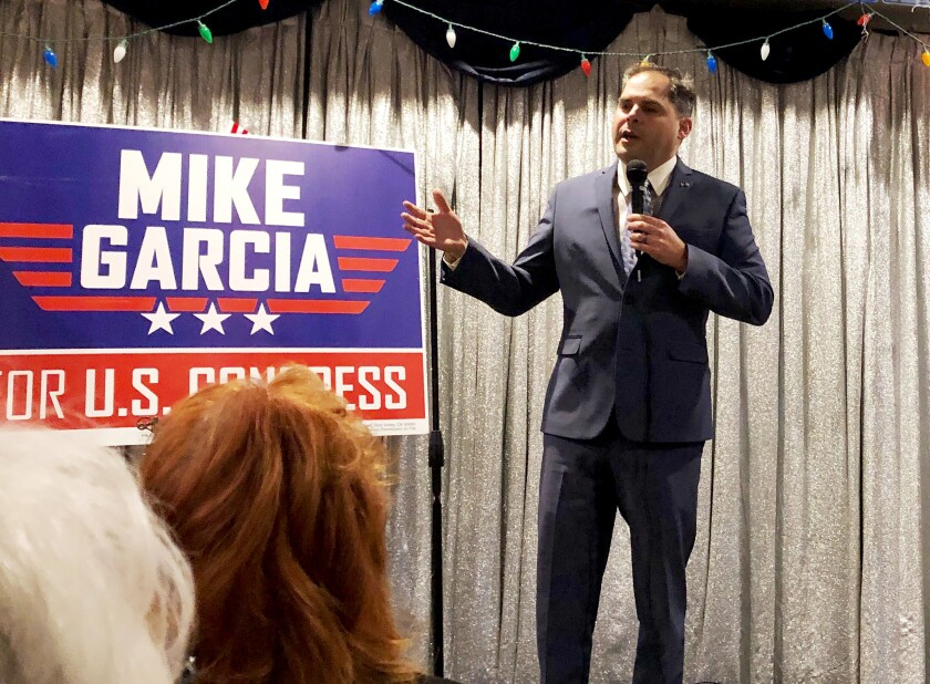 In this Tuesday, Jan. 28, 2020, photo, 25th District congressional candidate and former Navy combat pilot Mike Garcia addresses supporters in Simi Valley, Calif. (AP Photo/Michael Blood)