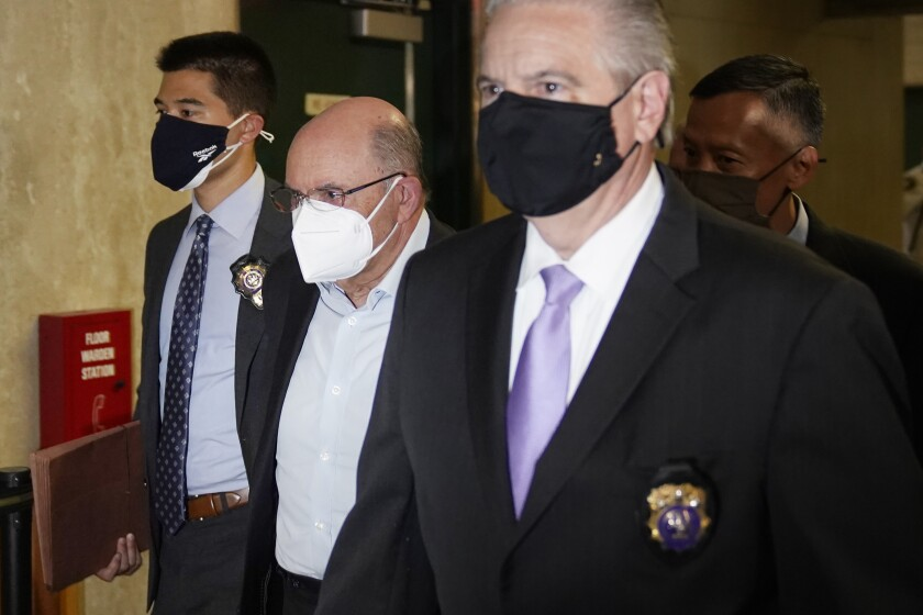 """The Trump Organization's Chief Financial Officer Allen Weisselberg, second from left, arrives to a courtroom in New York, Thursday, July 1, 2021. Donald Trump's company and its longtime finance chief were charged Thursday in what a prosecutor called a """"sweeping and audacious"""" tax fraud scheme that saw the Trump executive allegedly receive more than $1.7 million in off-the-books compensation, including apartment rent, car payments and school tuition.(AP Photo/Seth Wenig)"""