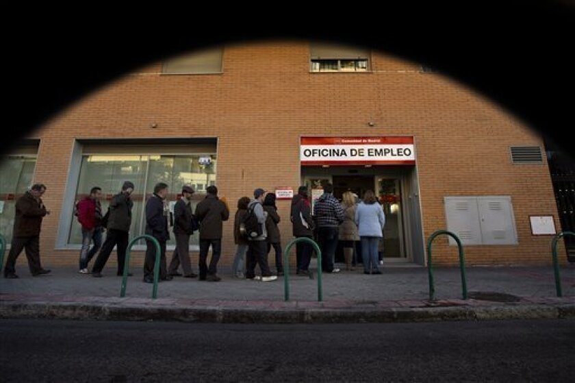 People queue to enter on an unemployment office, in Madrid, Monday, Feb. 4, 2013. Labor Ministry figures released Monday showed the registered jobless figure surged by 132,055 in January to 4.98 million. Spain is struggling to emerge from its second recession in just over three years.The country's unemployment rate was at 26 percent at the end of the fourth quarter, up 1 percent from the previous three-month period.(AP Photo/Daniel Ochoa de Olza)