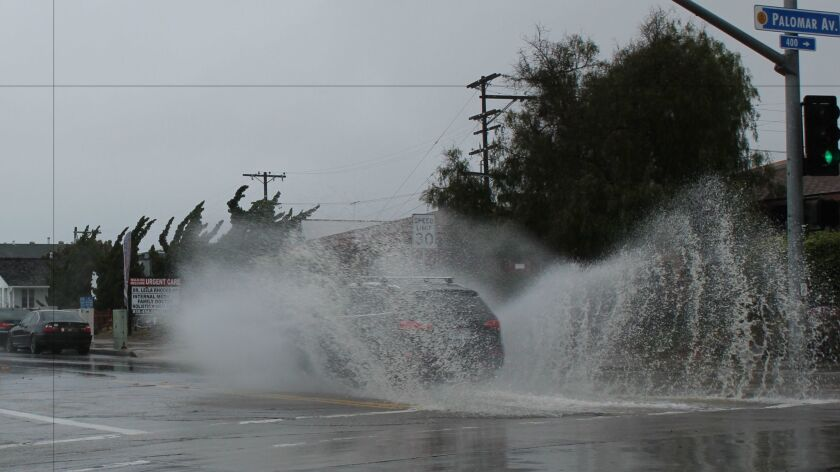 A dip on La Jolla Boulevard at Palomar Street filled with water during the Feb. 27 storm, provoking splashes from passing cars.