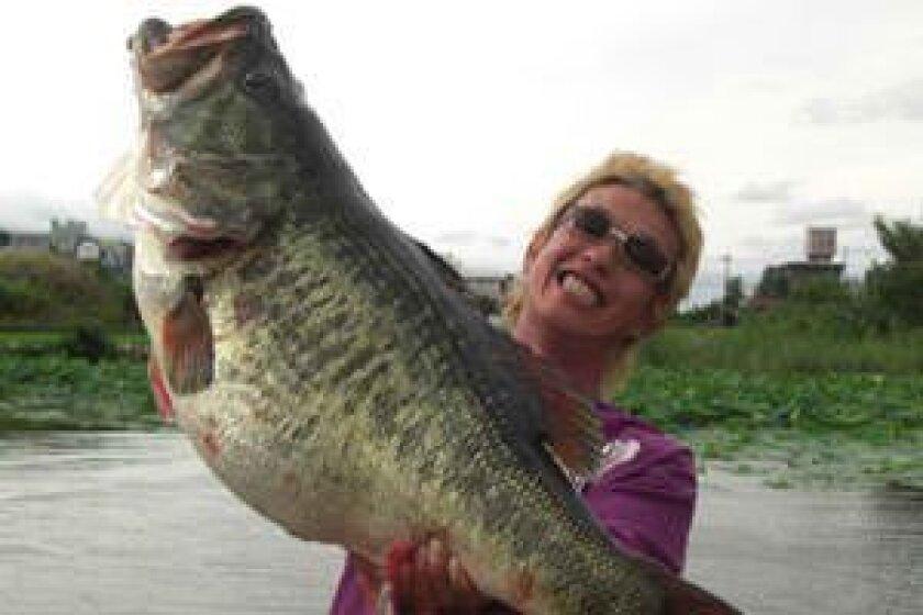 Manabu Kurita of Japan caught this world-record-tying 22-pound, 4.97-ounce largemouth bass in July of 2009 out of Lake Biwa in Japan.