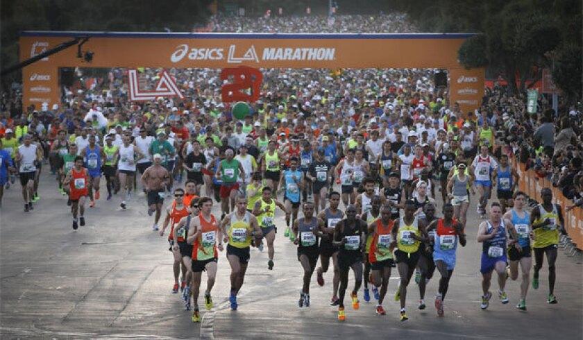 Runners start the 2013 ASICS L.A. Marathon at Dodger Stadium.