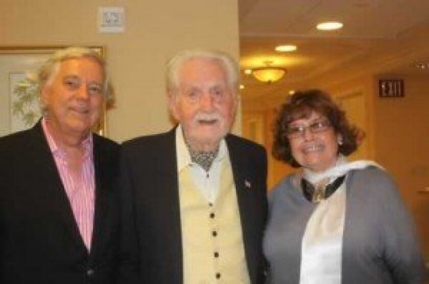 Les Stypinski (center) with his son, Tony, and daughter-in-law Gloria Stypinski at Les' centennial party