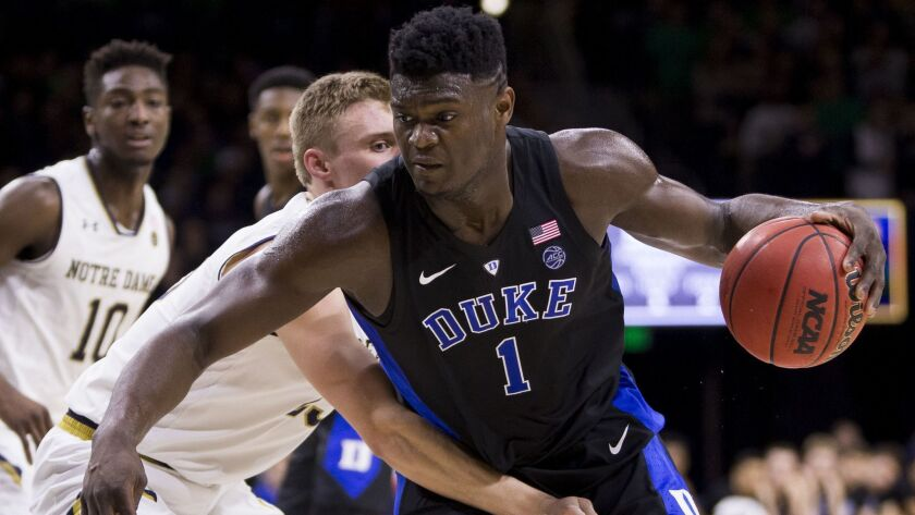 Duke's Zion Williamson (1) is defended by Notre Dame's Dane Goodwin (23) during the first half of an