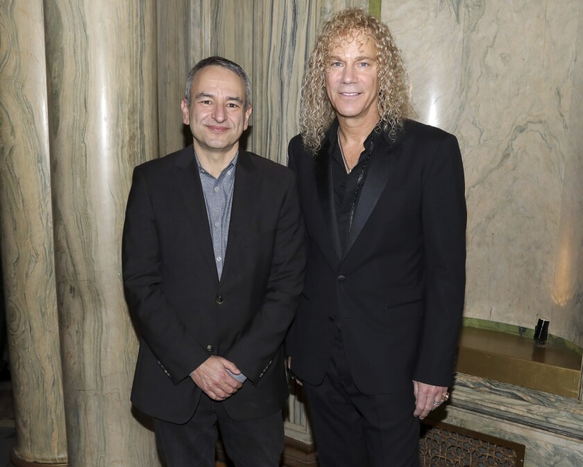 """FILE - This Jan. 30, 2020 file photo shows playwright Joe DiPietro, left, and David Bryan participate in a """"Diana"""" Broadway musical cast special performance in New York. Bryan, the keyboardist for Bon Jovi is embarking on a busy 2020, with a new album and tour with one of America's favorite rock bands as well as opening his second Broadway musical, """"Diana. (Photo by Greg Allen/Invision/AP, File)"""