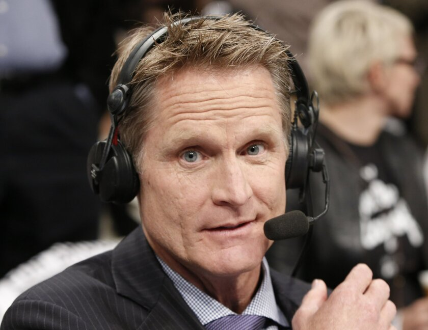 TNT commentator and former Chicago Bulls and San Antonio Spurs guard Steve Kerr broadcasts courtside for Game 4 of an NBA basketball first-round playoff series between the Toronto Raptors and the Brooklyn Nets, Sunday, April 27, 2014, in New York. Kerr said Sunday he spoke with New York Knicks Pres