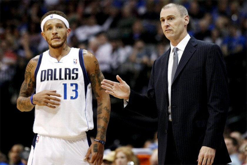 Delonte West, seen here with Dallas Mavericks coach Rick Carlisle, was waived by Dallas Mavericks to make room for Eddy Curry.