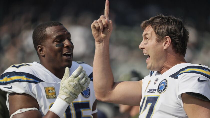 OAKLAND, CA, SUNDAY, NOVEMBER 11, 2018 - Philip Rivers and Antonio Gates share a chuckle on the side