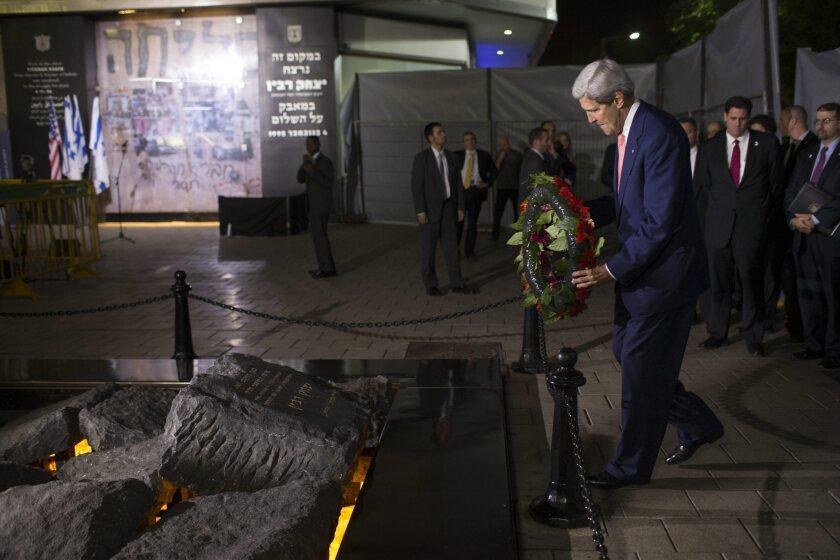 U.S. Secretary of State John F. Kerry lays a wreath at a memorial to former Israeli Prime Minister Yitzhak Rabin in Tel Aviv.