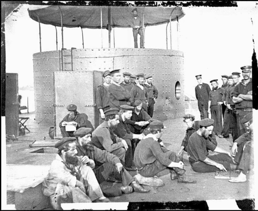 Crew members on the deck of the ironclad Monitor in an undated photo from the Civil War.