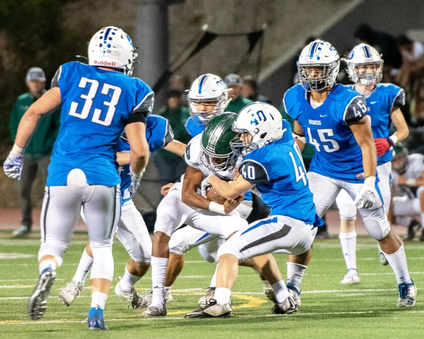 The Rancho Bernardo and Poway High football teams pictured in a 2019 game.