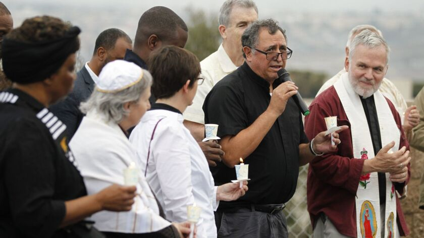 Rev. Jose Castillo speaks during an interfaith vigil for separated immigrant families at Our Lady of Mt. Carmel Catholic Church in San Ysidro on Friday.   Photo by Hayne Palmour IV/San Diego Union-Tribune