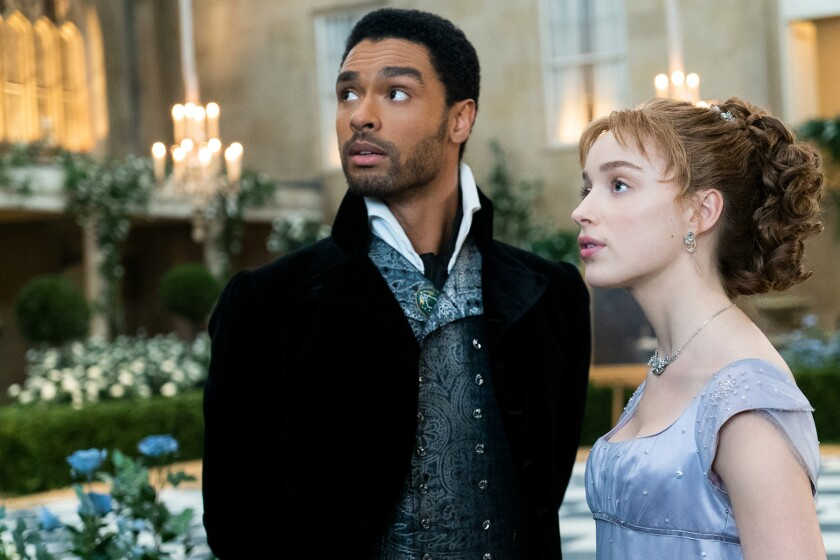 """Regé-Jean Page and Phoebe Dynevor in a scene from """"Bridgerton"""""""