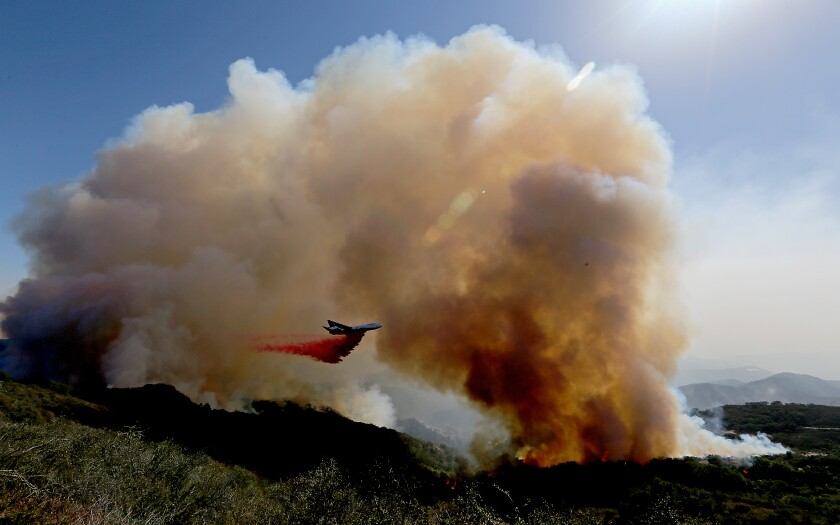 A firefighing airplane drops fire retardant ahead of the Alisal fire near Goleta on Wednesday.