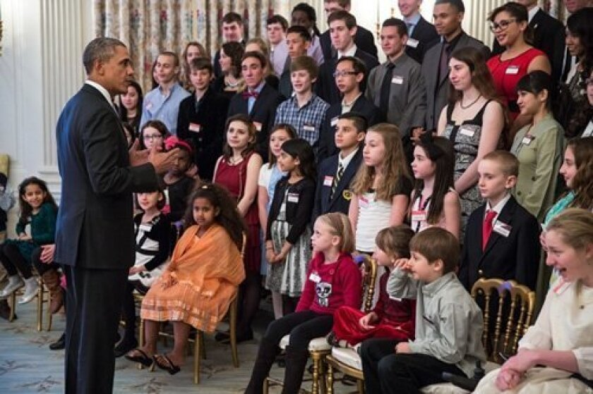 Lilly Grossman (lower right corner) and about 30 other students met with President Barack Obama as well as astrophysicist Neil deGrasse Tyson and Bill Nye (aka Bill Nye the Science Guy), in the East Room of the White House where several of the videos were screened and the president advocated for be