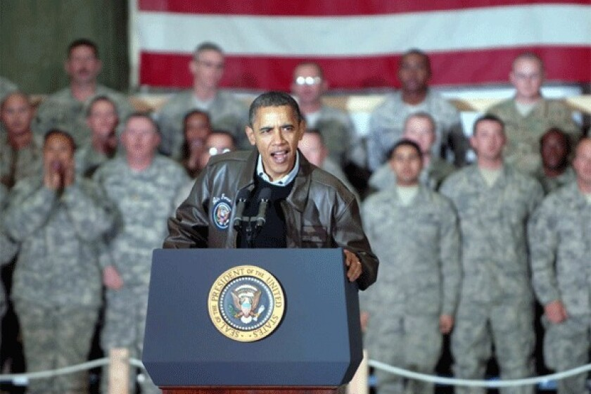 President Obama is seen waving to U.S. soldiers during a surprise visit to Afghanistan in Dec. 2010.