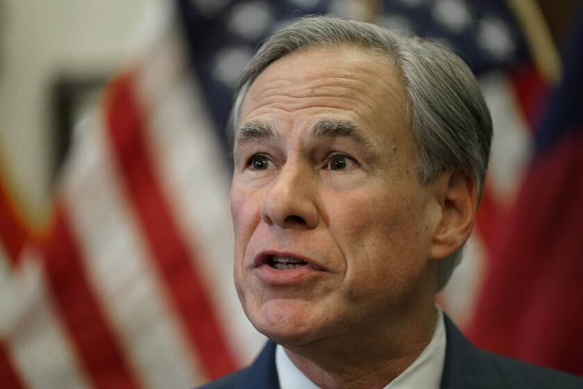 FILE - In this Tuesday, June 8, 2021, file photo, Texas Gov. Greg Abbott speaks at a news conference in Austin, Texas. Abbott is reviving the GOP's thwarted efforts to pass new voting laws in America's biggest red state. His announcement Wednesday, July 7, comes after Democrats temporarily derailed a restrictive bill with a late-night walkout in the state Capitol in May. (AP Photo/Eric Gay, File)