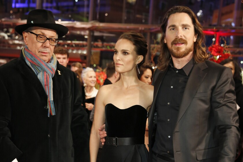 """From left, Berlin festival director Dieter Kosslick, actors Natalie Portman and Christian Bale pose for photographers on the red carpet of the film """"Knight of Cups"""" at the 2015 Berlin Film Festival."""