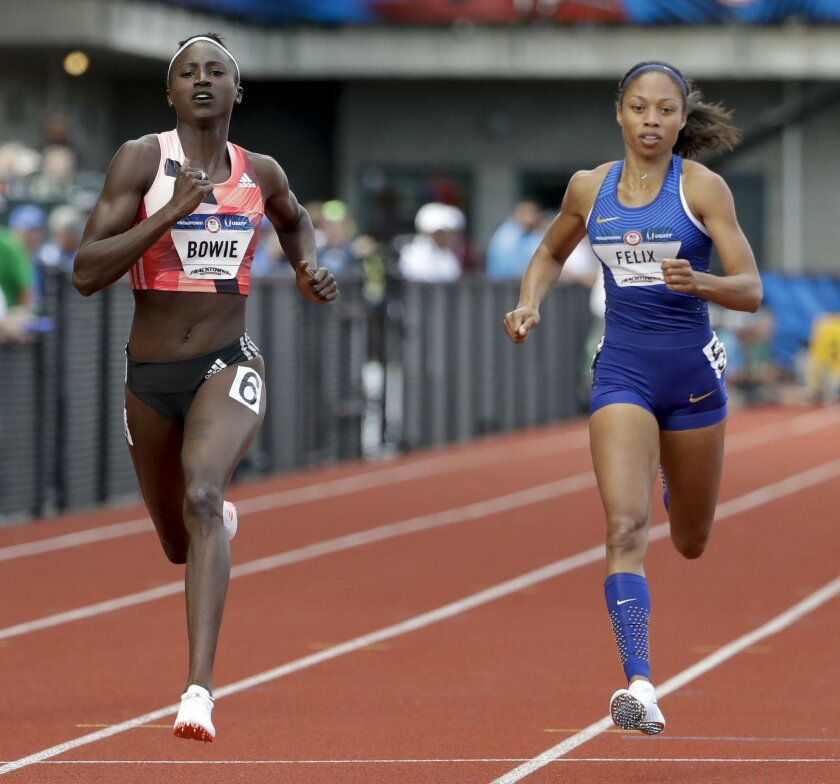 Tori Bowie, left, edges out Allyson Felix in thier heat during the semifinals of the women's 200-meter run at the U.S. Olympic Track and Field Trials, Saturday, July 9, 2016, in Eugene Ore. (AP Photo/Marcio Jose Sanchez)