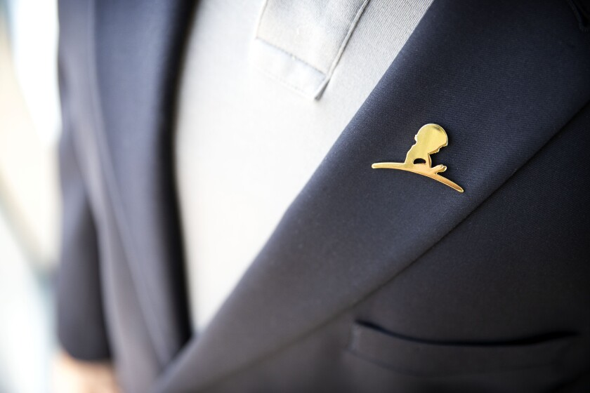 A St. Jude Children's Research Hospital lapel pin on a jacket.