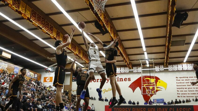Mission Bay's Boogie Ellis (5) hits a layup in the third period against O'Dea.