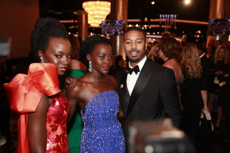 """Black Panther"" stars Danai Gurira, Lupita Nyong'o and Michael B. Jordan are photographed in the Beverly Hilton International Ballroom during the 76th Golden Globes."