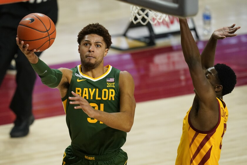 Baylor guard MaCio Teague drives to the basket ahead of Iowa State guard Jalen Coleman-Lands, right, during the second half of an NCAA college basketball game, Saturday, Jan. 2, 2021, in Ames, Iowa. Baylor won 76-65. (AP Photo/Charlie Neibergall)