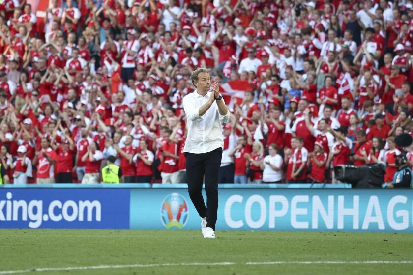 Denmark's managaer Kasper Hjulmand applauds fans as he walks off the field after the Euro 2020 soccer championship group B match between Denmark and Belgium, at the Parken stadium in Copenhagen, Thursday, June 17, 2021. Belgium won 2-1.(Wolfgang Rattay, Pool via AP)