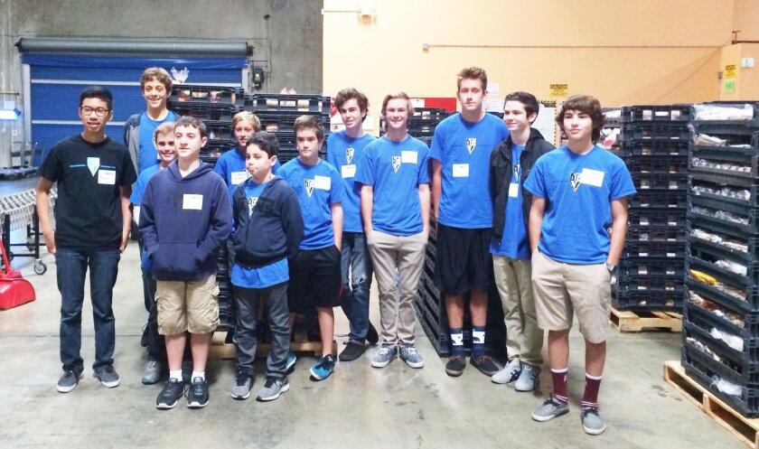 Teen Volunteers in Action, Chapter 2, volunteered at Feeding America in December.