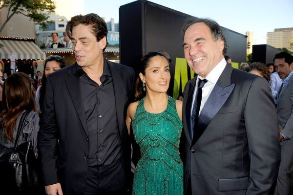 "Actors Benicio Del Toro, left, Salma Hayek and director Oliver Stone arrive at the premiere of ""Savages."" Director Oliver Stone's ""Savages"" takes place in Laguna Beach, where young entrepreneurs Ben and Chon create a lucrative marijuana business. When Mexican drug cartel Baja Cartel asks for a partnership and is denied, kidnapping and violence follow. Click through the gallery to see photos from the premiere at Westwood Village."
