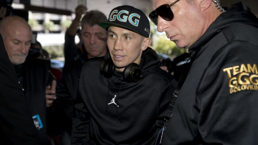 WBC/WBA middleweight champion Gennady Golovkin, center, of Kazakhstan, arrives at the MGM Grand hote