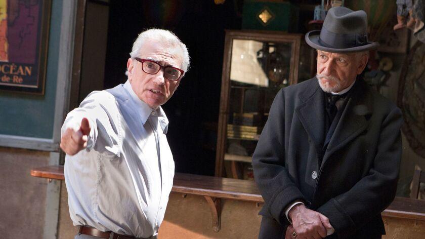 """Martin Scorsese, left, directs Ben Kingsley on the set of """"Hugo."""""""