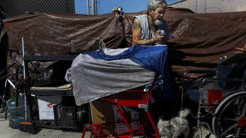 LOS ANGELES, CA MARCH 5, 2018: Santiago Robles, 60, stands outside his tent on South Hope Street i