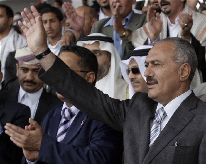 FILE - In a May 6, 2011 file photo, Yemeni President Ali Abdullah Saleh waves to his supporters, during a rally in his support in Sanaa,Yemen. A government official says Yemeni President Ali Abdullah Saleh has been moved to the Defense Ministry hospital for treatment after being wounded in a rocket attack Friday, June 3, 2011 on his palace. (AP Photo/Hani Mohammed)