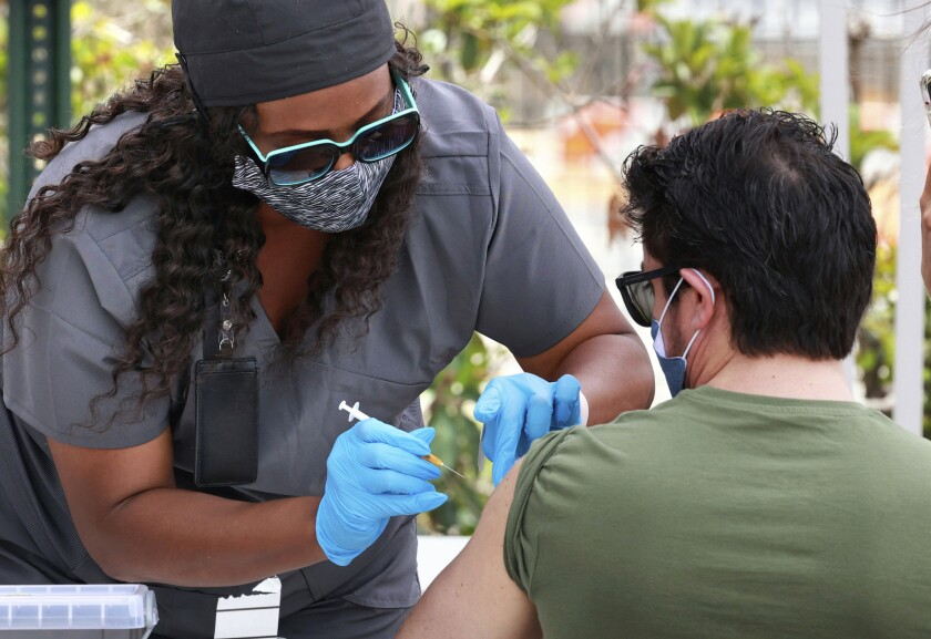 An Orange County resident receives the COVID-19 vaccine in Florida