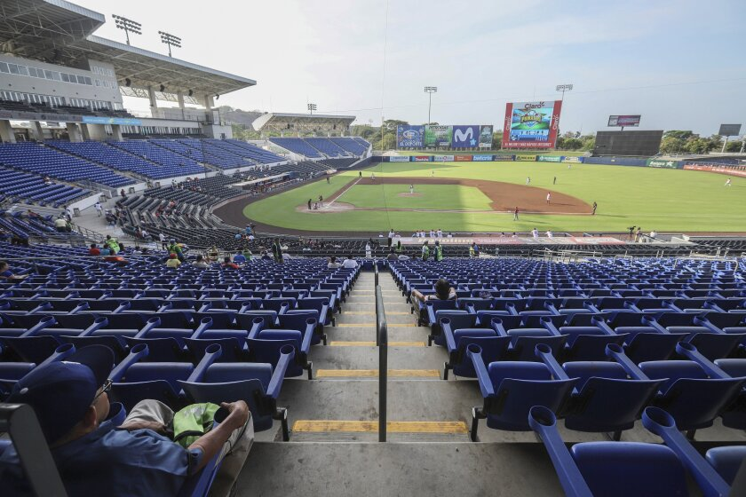 A man watches a professional baseball game between Boer de Managua and Flecheros de Matagalpa at Dennis Martinez stadium in Managua, Nicaragua, Saturday, April 25, 2020. As the new coronavirus spread and economies shut across Latin America, Nicaragua stayed open _ schools, stores, concert halls, and baseball stadiums, all operating uninterrupted on orders of a government that denied the gravity of the disease. (AP Photo/Alfredo Zuniga)