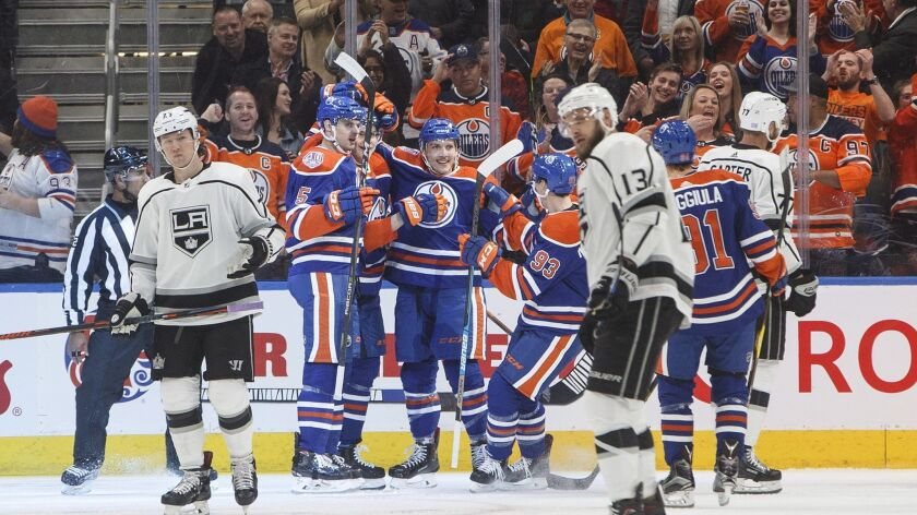 Edmonton Oilers celebrate a goal against the Los Angles Kings during first-period NHL hockey game ac