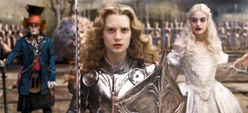Burton and company have taken special care to provide pictures of Alice (Mia Wasikowska) as a warrior princess in full Joan of Arc armor as a female empowerment icon for the girls in the audience.