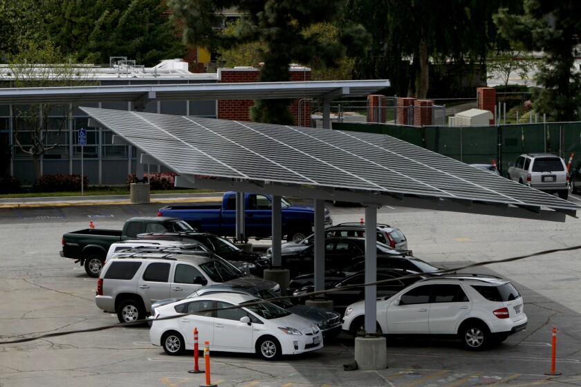 A new government-run energy program approved by L.A. County supervisors would include solar projects like this parking canopy at Taft High in Woodland Hills.