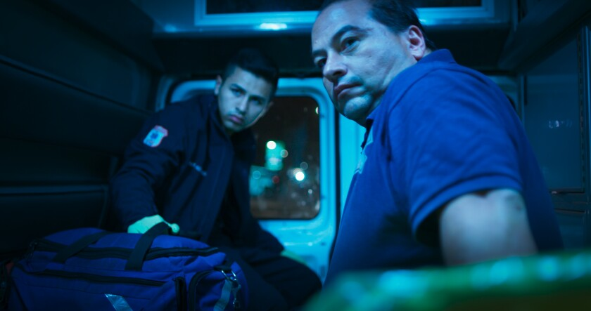 Juan Ochoa and Fernando Ochoa ride in the back of their family's ambulance in the documentary 'Midnight Family'