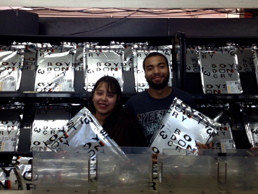 Frank Ocean fans Iri Reza and Cornelius Hall, who scored copies of Frank Ocean's new album and zine at a West Hollywood pop-up shop.